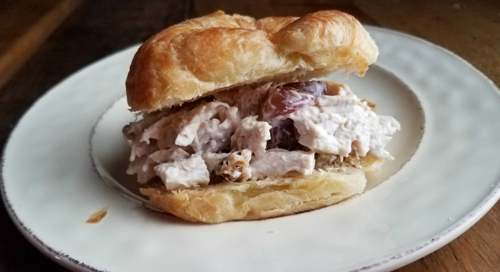 Enjoy chicken salad sandwich with savory grapes on a crossaint. A delish dish for lunch or dinner. #easymeals - eattravellife.com