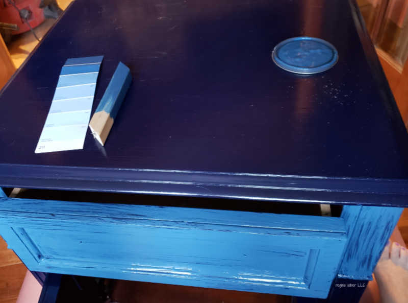 blue paint on table