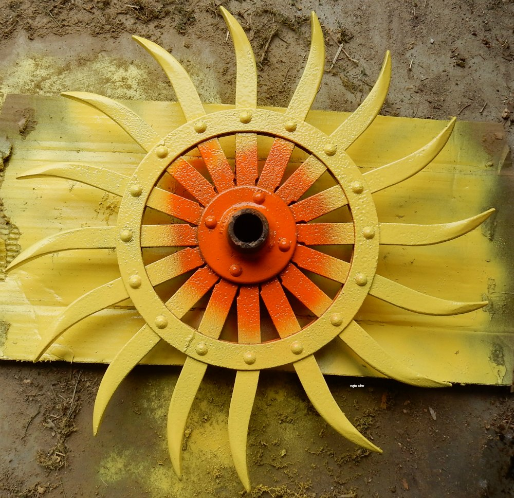 Farm parts make the best diy projects. You can paint farm parts and make them into flowers. Check out how to make a sunflower. - eattravellife.com