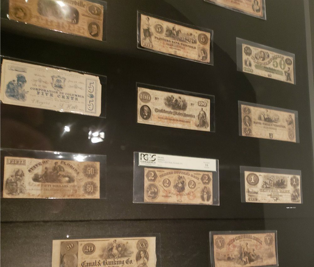 Explore the Confederate Currency at the National Underground Railroad Freedom Center in Cincinnati Ohio. See some of the images displayed on the currency in paintings by artist John W Jones. - eattravellife.com
