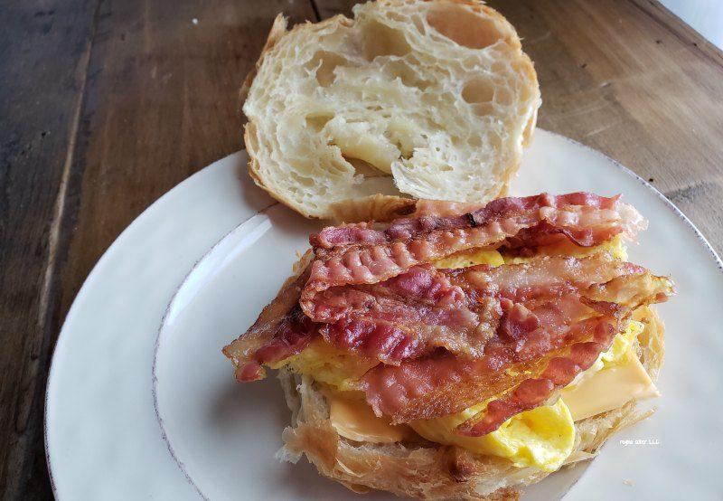 bacon egg cheese croissant sandwich
