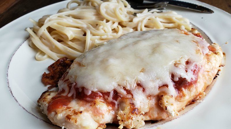 Love Italian food? You need to make this chicken parmesan recipe. A baked chicken parmesan crisps up and is perfectly in the oven. Lots of cheese! Leftovers make great chicken parmesan sandwiches!